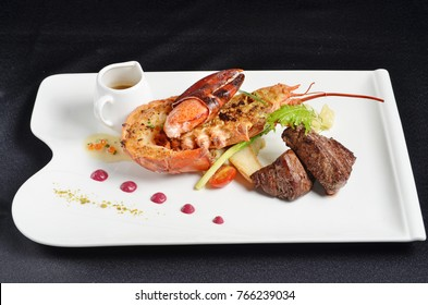 Grilled beef meat with lobster and sauce on white plate