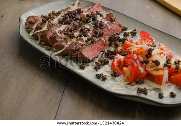Grilled beef on a serving plate