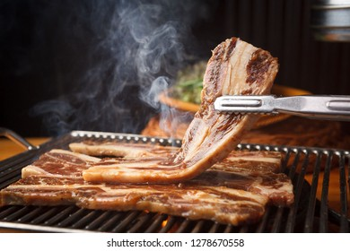 Grilled beef ribs on a plate