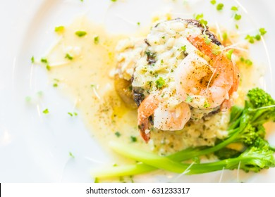 Grilled beef and shrimp or prawn steak in white plate