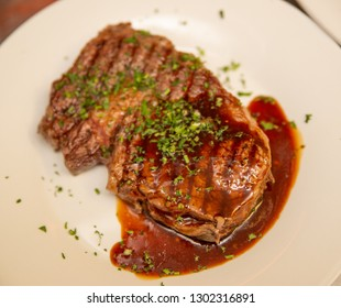 Grilled beef sirloin steak with sauce