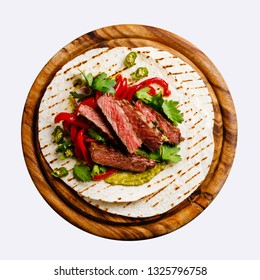 Grilled Beef steak Fajitas taco tortillas with green salsa and bell pepper isolate