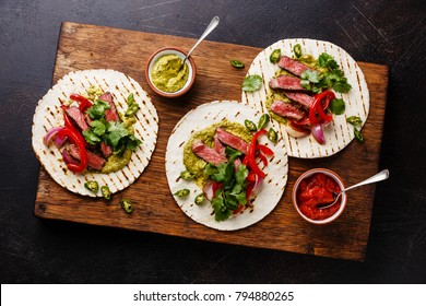 Grilled Beef steak Fajitas taco tortillas with salsa and bell pepper