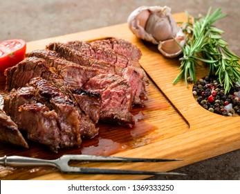 grilled beef steak on wooden background