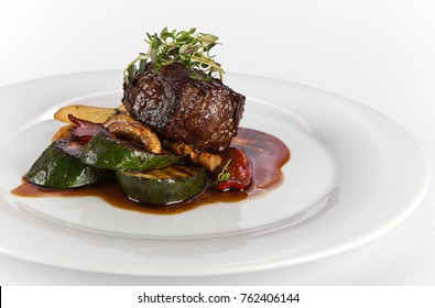 grilled beef steak rare sliced with vegetables on white background