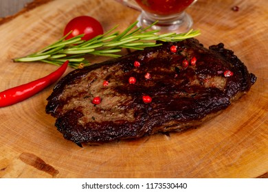Grilled beef steak with red pepper