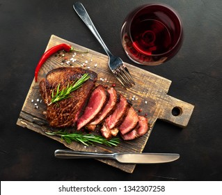 Grilled beef steak with red wine, herbs and spices. View from above