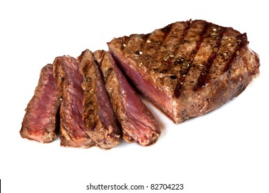 Grilled beef steak, sliced, isolated on white background.