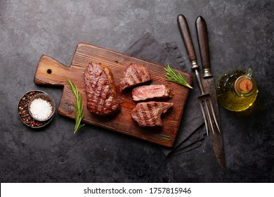 Grilled beef steak with spices and herbs. Top view flat lay