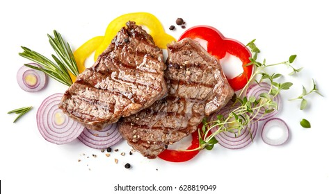 grilled beef steak and vegetables isolated on white background, top view