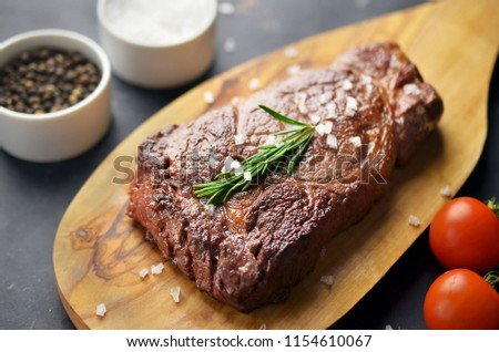 Grilled beef steak with vegetables on cutting board