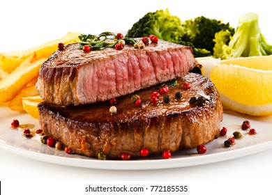 Grilled beefsteak with french fries and broccoli on white background