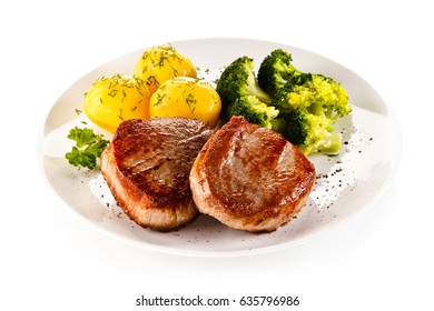 Grilled beefsteak with potatoes and broccoli on white background