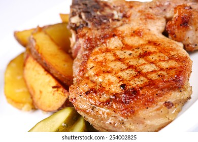 Grilled beefsteak with potatoes on white