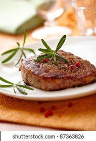 Grilled beefsteak with rosemary on a plate
