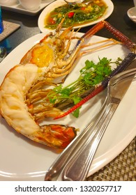 Grilled big Freshwater Shrimp cut in half piece serve with seafood sauce