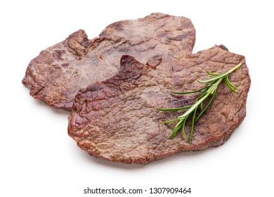 Grilled bio beef steaks with spices isolated on white background.