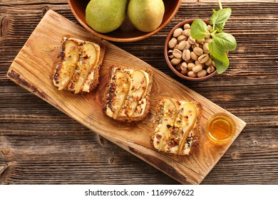 Grilled blue cheese sandwich with pears pistachios and honey