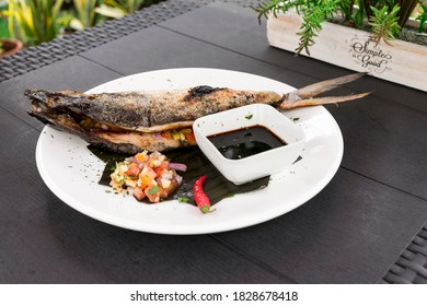 Grilled Boneless Bangus stuffed with vegetables and served with soysauce and Atchara. Bangus is also known as Milkfish.