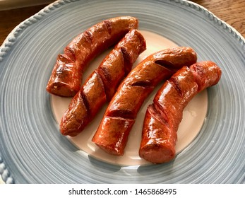 Grilled Bratwurst Sausage in Plate Ready to Serve. Fast Food.