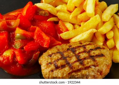 Grilled burger with fries and mexican sauce