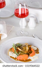 Grilled carp with stewed tomatoes and a glass of lingonberry juice