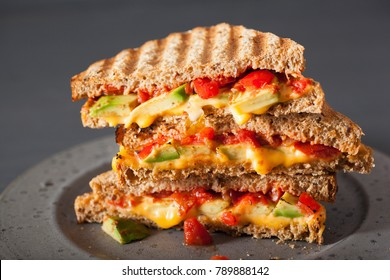 grilled cheese sandwich with avocado and tomato