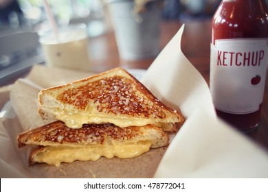 Grilled cheese sandwich fresh made with cheddar and ketchup bottle