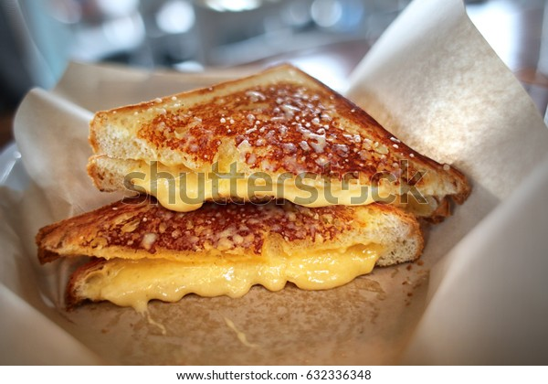 Grilled cheese sandwich gourmet four cheese in basket cut in half melted