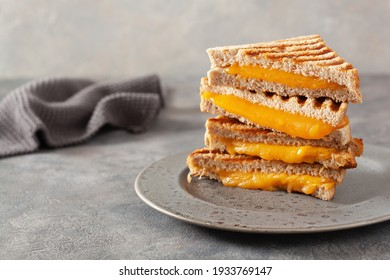 grilled cheese sandwich on gray concrete background