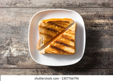 Grilled cheese sandwich on wooden table. Top view