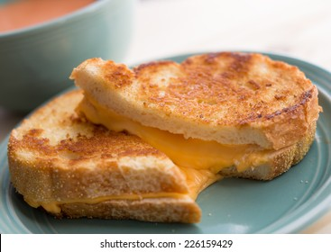 Grilled cheese sandwich with tomato soup.