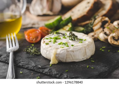 Grilled cheese with vegetable, olive oil, garlic and herbs