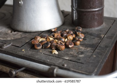 Grilled Chestnuts on a Heating Stove in a Country House in a Small Town of Anatolia