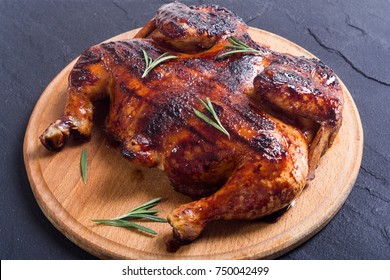 Grilled chicken background with pepper and rosemary