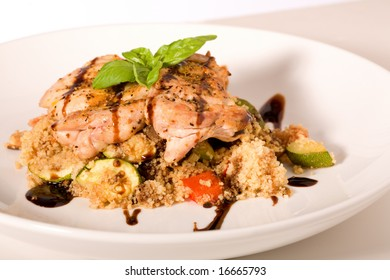 Grilled Chicken with Balsamic Vinaigrette on bed or rice.