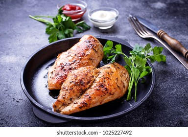 Grilled chicken breast or fillet on iron pan. Top view
