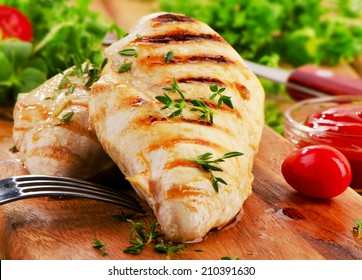 Grilled chicken breast with fresh vegetables . Selective focus