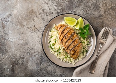 grilled chicken breast with herb couscous, top view