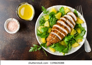 Grilled chicken breast with pineapple and arugula. Salad with lemon sauce
