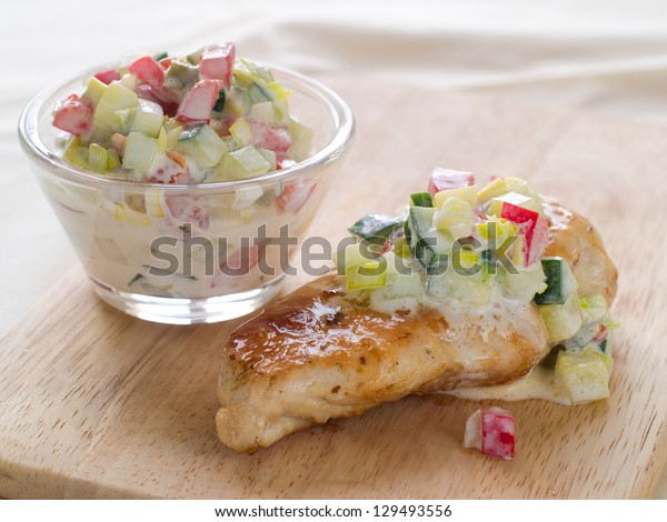 Grilled chicken  breast with salad, selective focus