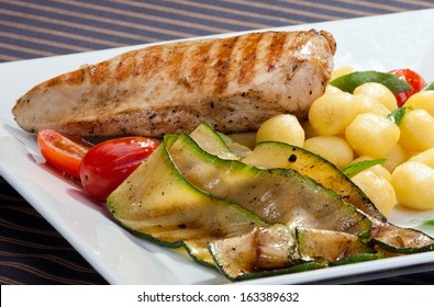 Grilled chicken breast w grilled aubergine and italian dumplings