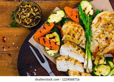 Grilled Chicken Breasts with Grilled Vegetables Zucchini and Carrot. Selective focus.
