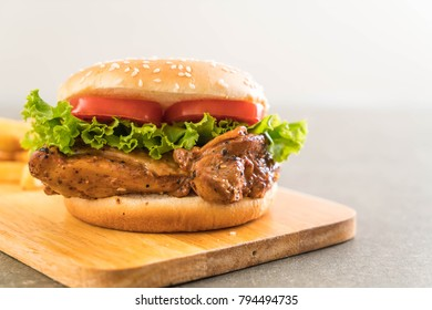 grilled chicken burger with french fries - unhealthy food