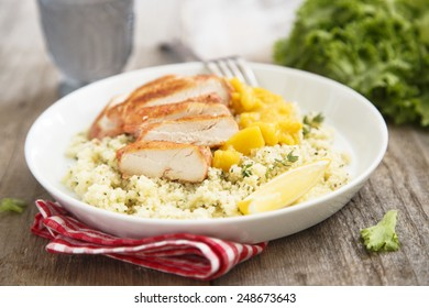 Grilled chicken with couscous and mango