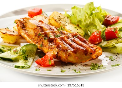 Grilled chicken fillet, baked potatoes and vegetables
