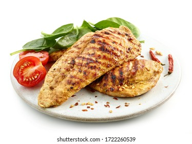 grilled chicken fillet on white plate isolated on white background