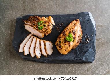Grilled chicken fillets on slate plate
