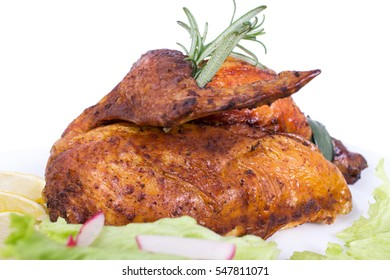 Grilled chicken with fresh herbs and lettuce