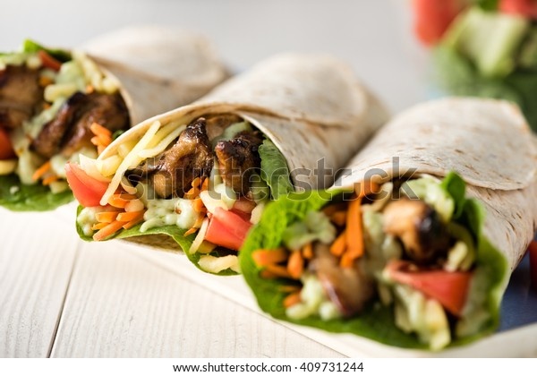 Grilled chicken with fresh vegetable burrito wraps